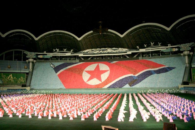 Die nordkoreanischen Fans sind für ihre Fußballleidenschaft und ihre kreativen Choreographien weltweit berühmt. (Quelle: http://www.flickr.com/photos/kansai/2228900333/, licensed under CC BY-NC-ND 2.0)